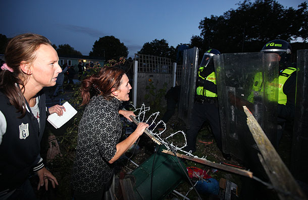 Dale Farm Travellers holding a blockade in front of riot police