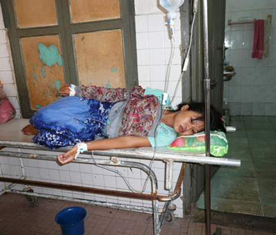 Female Cambodian worker being treated at a basic health cenre