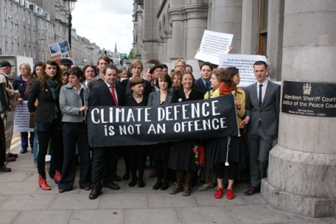 The Climate 9 defendants with family and supporters